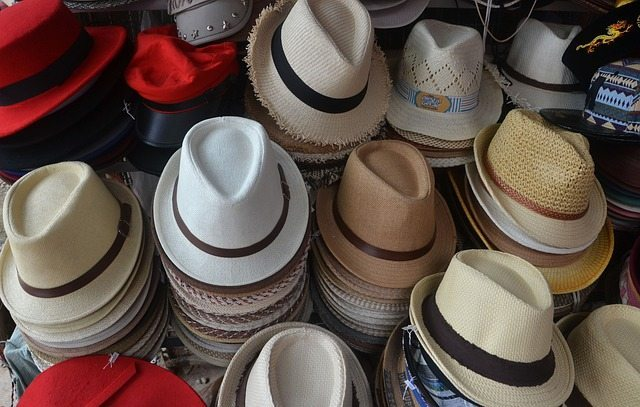 Finding your hat size involves measuring your head, trying on different hats, or both.