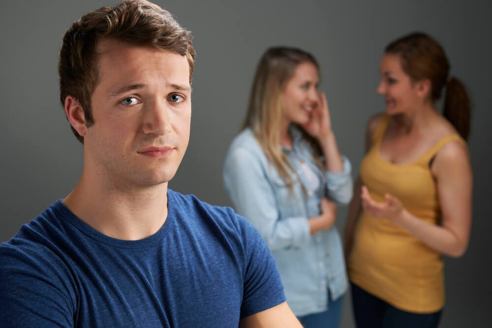 Worried Man Being Talked About By Women